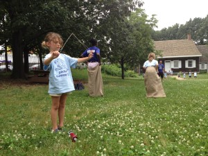 Children from a summer camp visit the Wyckoff farmhouse