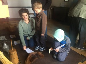 A group of visitors at a recent Wyckoff farmhouse family day explores the collection of hands-on artifacts