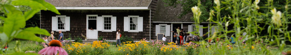 Visitors enjoy the Wyckoff House Museum grounds on a summer day