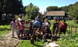 Children visiting on a school field trip learn in the Wyckoff farmhouse garden.