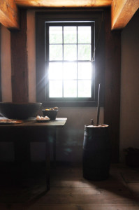 Window, butter churn, and kitchen implements in the Wyckoff House's old kitchen