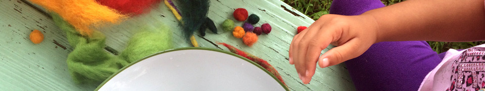 Young visitors to the museum make felt beads from dyed wool