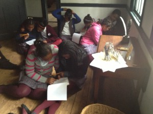 Middle school students examine slave bills at the Wyckoff House Museum
